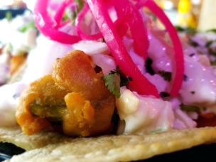 Fried Avocado Taco - lightly battered avocado topped with pickled onions, jicama slaw, and lime crema all on a corn tortilla found at Matador Taco & Tequila Bar Milwaukee, WI